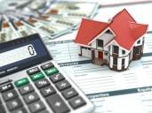 מחשבון, דגם של בית וטפסים של ביטוח דירה למשכנתא